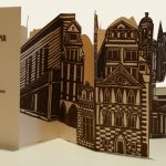 Dystopia - 2007, 9 x 4 x.5 inches, edition of 30, linoleum block prints with digitally printed cover Cut, folded, and bound, open the cover and a three-dimensional city emerges, unfolds, metamorphoses.
