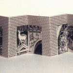 "Memory: Prague - 1996, 2 1/2 x 2 3/4 x 5/8 inches, edition of 15. 3 color lithograph accordion book pops out of a box-like structure. The repetition of ""word"" forms a visual texture that is incorporated with the hand-drawn images of Prague building ornamentations."