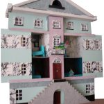 Dollhouse, 2003, 22 x 22 x 6 inches, museum board, foam core, decorative papers, cover stock.
